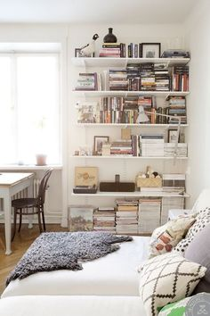 When you're living in a small space, every detail counts. But sometimes those little things — the things that elevate a place from not quite right to effortlessly chic — can be hard to identify. So we're sharing a few of our favorite small space decorating tips with you. Our first bit of advice? Swap your freestanding bookshelves for wall-mounted shelving.