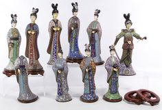 Lot 553: Asian Cloisonne Figurine Assortment; Including ten female figurines with cloisonne bodies, carved wood heads and applied metal decorations; together with eight carved wood stands