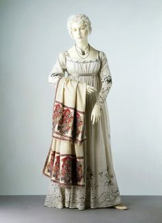 White muslin evening dress with scarf. 1805-1810, possibly made in France. Materials and Techniques: Muslin, embroidered with cotton and silver thread, lined with linen, hand-sewn