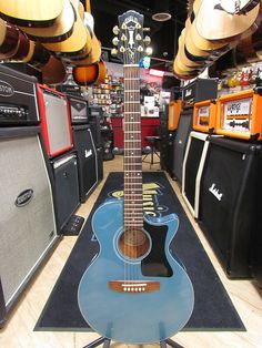 Very rare bird.. They only made 400 total of these and even fewer in blue. Solid spruce top, 1 piece carved mahogany back & sides. Guild/Fishman pick up system, gold Grover tuners, rosewood board w/ pearl dot inlays, great guitar for live performance. Has original hard shell case included. Th...