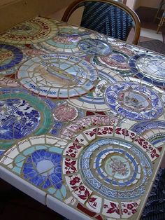Interesting mosaic table top made with broken china plates.