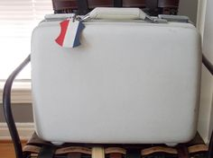 1950s American Tourister Tri-Taper Small White Suitcase with Original Tag - http://oleantravel.com/1950s-american-tourister-tri-taper-small-white-suitcase-with-original-tag