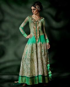 Sea Green Anarkali Suit with embroidery on neckline   1. Anarkali Suit is sketched and drafted in a shade of sea green. The top is enriched with the fabric of embroidered net and tissue which is accentuated with laces on it. The yoke and kali is zari embroidered which is complimented with beautiful and work on neckline.2. Comes with matching bottom and dupatta3. Sizes available: M, L, XL, XXL