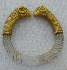 Bracelet of rock crystal with gold rams heads, Greek, part of the Ganymede Jewelry collection, 330-300 BCE. see also http://www.metmuseum.org/toah/works-of-art/37.11.8-.17
