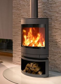 Contemporary wood-burning stove (rotating) - EMOTION M - ArchiExpo