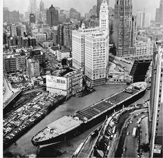 Aerial view of the Marine Angel, the largest vessel to travel the Mississippi River and the Illinois Waterway, as it rounds a sharp bend in the Chicago River, Chicago, Illinois, 1953, uncredited