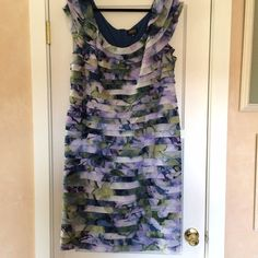Adrianna Papell dress Beautiful dress! It has a watercolor pattern on it. It has shades of purple, blue, and green. It has layers down the front. Short cap style sleeves. It zips down the back for easy entry. Great for parties. Marked as 22W. Adrianna Papell Dresses