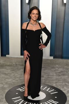 Stunner: Michelle Rodriguez wore a sizzling black gown with a racy thigh split. Emily Ratajkowski Vanity Fair, Michelle Rodrigues, Black Lace Gown, Dress Black, Balmain Dress, High Low Gown, Looking Dapper, Vanity Fair Oscar Party, Red Carpet Looks