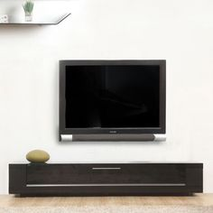 Streamline your entertainment room with this Roma Remix wooden TV stand. It features unique technology that allows you to hide all your components without interfering with the use of your remote controls. The sleek stand is compatible with most TVs.
