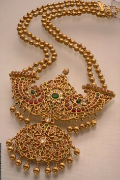 jewelry design   Long temple jewellery haram with double layer 22carat gold beads and ...