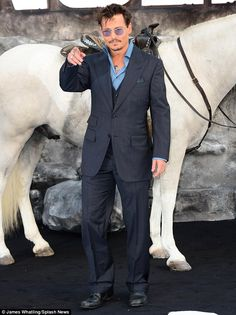 The Lone Ranger: While Armie brought his wife Elizabeth Chambers along, his co-star Johnny Depp walked the cow hind style carpet minus his girlfriend Amber Heard