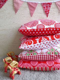 The Christmas pillows I made and sold in 2012. I really loved working with these prints.  by www.MyRoseValley.blogspot.com