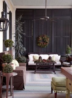 Allen Smith's Moss Mountain Farm, Photographed by Nancy Nolan for Home in Arkansas Magazine www. A wall of shutters screens the sun from the lower porch, which is adjacent to the parlor and is a favorite al fresco gathering spot. Outdoor Rooms, Outdoor Gardens, Outdoor Living, Outdoor Decor, Outdoor Seating, Interior Exterior, Home Interior, Exterior Colors, Shutter Wall