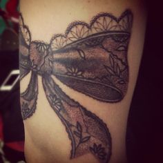 """Black lace ribbon bow tattoo ink. The tattoo artist name is Pin from Venice Beach on the board walk. The shop is called """"Side Show"""""""