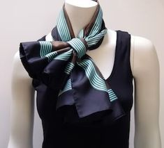 Hermes 90 Carré with a shawl ring in a criss-cross knot  fantastic way to wear a scarf!