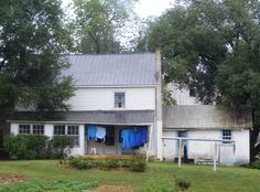 Amish farmhouse with laundry on porch -