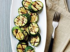 Grilled Zucchini with Sea Salt | Zucchini and other summer squashes are abundant in backyard gardens, farmers' markets, and grocery stores this time of year. Try these recipes to use up your supply.