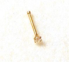 gold cz claw set nose stud This is a pretty and dainty ball end nose stud set with a high quality 1 5 mm round clear cubic zirconia The stone is Body Jewellery, Jewelry, Nose Stud, Stone Cuts, Claws, Solid Gold, Belly Button Rings, Arrow Necklace, Pretty