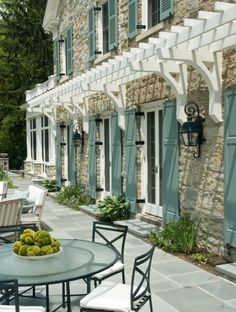 love the blue shutters and little trellis