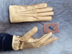 Mens deerskin leather gloves featuring 3 handsewn point detail and strap and…