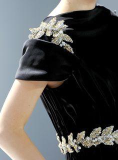 Chanel - I love the details on her shoulder.
