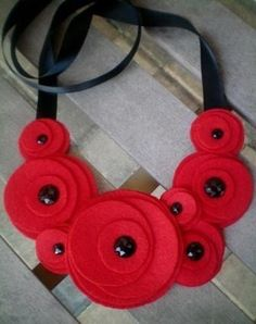 Bib necklace...flower necklace...felt...statement...Flower Swirl Necklace (red). $20.00, via Etsy.