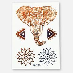 Das Metallic Tattoo 220 mit einem Elefantenkopf in Gold, einer Blume in Gold und einer in Silber sowie 2 dekorativen Elemente in Gold und Silber. Das Blatt im Format 102 x 72 mm enthält 5 Sujets.