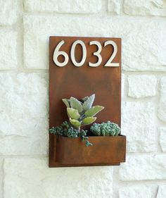 Model #: Sucker for Succulents Planter    Welcome Home. This modern address plaque and wall planter adds flair and style to the facade of your home