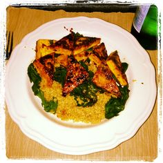 Tofu in a homemade sweet chili sauce (Lime, gluten-free soy sauce, spicy Thai chili, and chili flakes) with steamed Spinach on quinoa! #glutenfree #vegan #spicy