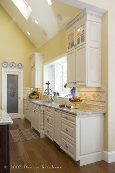 """Love the frosted glass door to the pantry. detail says """"PANTRY"""" on it- I would love this as a pocket door."""