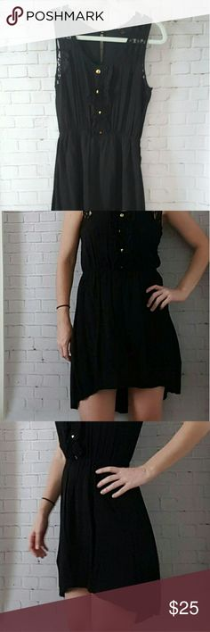 SALE *Black high low dreas Black dress with high low hem. Light material with built in slip layer in the skirt. Gold colored buttons and ruffle detial on front. Lace detail in shoulder. Mine  Dresses