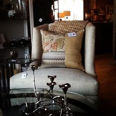 Curl up with a book in your favorite comfy chair. Iowa Interior Designers | Surroundings Interiors