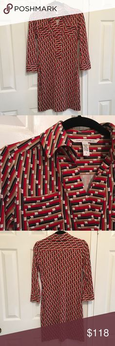 DVF Shirt Dress Must-have DVF classy dress in red, cream, and black print.  100% silk.  Long sleeves and front patch breast pockets.  In mint condition. Diane von Furstenberg Dresses Midi
