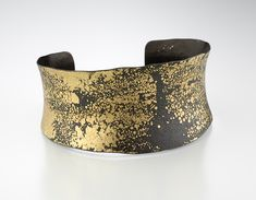 Iron & Gold Cuff - Created by Pat Flynn - open cuff iron bracelet is the backdrop for 22k gold dust - 1005 dollars