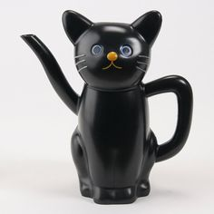 black cat teapot ... sitting upright, with tail winding behind its back as handle and spout, ceramic