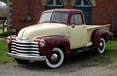 1952 Chevy Pickup.  Replace the maroon with black and you would be looking at the paint-job for my truck.