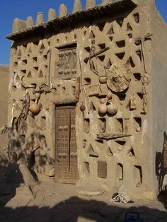 Dogon house with fetishes to protect the family. Most of the Dogon people are animists although there are also small Muslim and Christian communities in Sanga.
