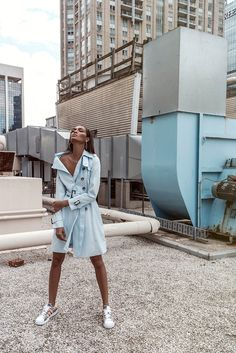The Puerto Rican model sports a short trench in blue