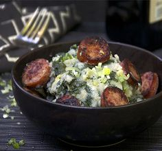 Dutch Stamppot - comfort food of the Netherlands - potato and kale mash topped with smokey sautéed sausages.