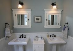 Like the beadboard and pedestal sink...thinking of downstairs bathroom