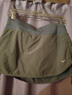 This is a size small Nike Gray skirt with a short underneath and a tie-dye gray on the sides of the skirt are drawstrings in the back of the skirt is a zipper pouch and inside is also a zipper pouch these are Dri-Fit dry super fast only worn a couple times perfect condition