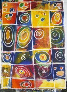 The kids first sketched out their 3 or 5 circles with pencil, and painted their entire square with acrylic paint. When the acrylic was dry, the painting was touched up with some oil glazes and the circles and squares were outlined with white paint.