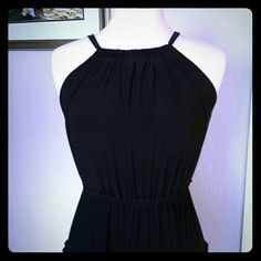 Black maxi dress size small Pretty black maxi dress with bow tie back. Made of polyester/spandex. In great condition. Dresses Maxi