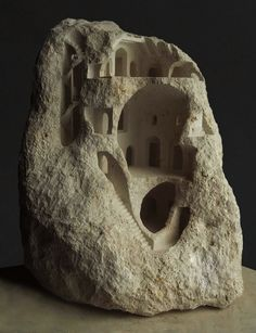 Matthew Simmonds (previously) sculpts miniature architectural structures from raw stone. Part of his interest in producing these pieces is centered around the contrast between the carved precision of his hand against the rough nature of the natural material he chooses for each work. The pieces&#