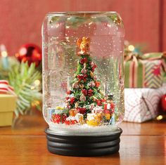 do NOT pay $45. wide mouth canning jar. resin tree. water, glycerin and a sealing compound. oh and snow. instant happiness.