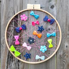 Get rid of those ugly ribbons in the bathroom and make this to hold all those bows! Plus, it's like artwork for the bathroom!
