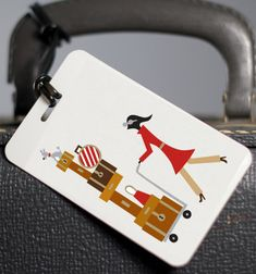 "The ""Luggage"" luggage tag.  I LOVE red and brown, btw."