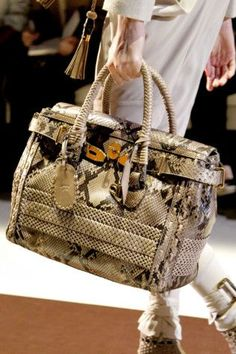 Gucci.....I so want this as my carry on bag!