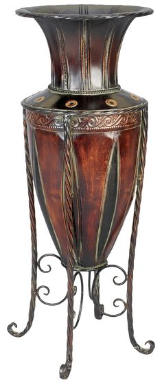 Features:  -Color: Bronze.  -Finish: Polished.  -Material: Iron metal.  Product Type: -Floor vase.  Shape: -Amphora.  Color: -Bronze.  Primary Material: -Metal.  Outdoor Use: -Yes. Dimensions:  Overal