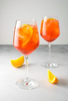 A classic and simple Italian apertivo cocktail. The Aperol spritz is made with prosecco, aperol, and soda water.